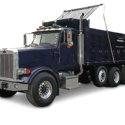 Mountain Tarp Flip Tarp system installed on a tri axle dump truck