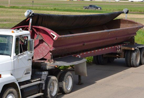 Mountain Tarp, Smooth Roll Side Dump Tarp System on a Red Trailer