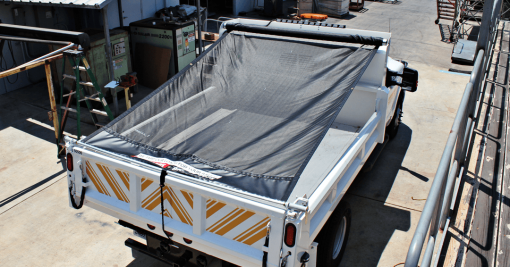 Pulltarp system with mesh tarp on a single axle dump truck