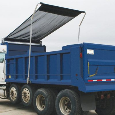 Shur Co Arm-Matic Flip Tarp System deploying over a load on a quad axle dump truck.
