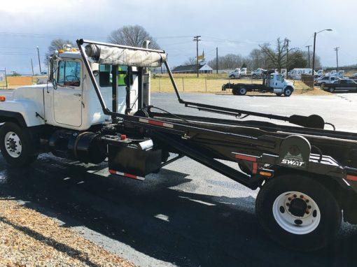 Donovan SWAT Auto Tarper on a Roll Off Truck