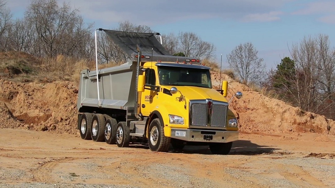 Mountain Tarp Electric Flip Tarp System, Model KCSE on a quad axle dump truck