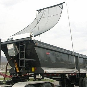 Mountain Tarp, flip tarp system with black mesh tarp on a scrap trailer