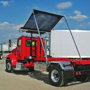 Roll-Rite DC203 Auto Tarper with the Gantry elevated and Straight Swing Arms on a Hook Lift Roll-Off Truck