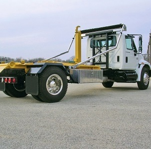 Roll-Rite DC203 or DC204 Auto Tarper with 45 Degree Elbow Arms on a Hook Lift Roll-Off Truck