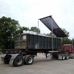 Roll-Rite DC300 Roll Off Trailer Tarp System with Tarp Partially Deployed